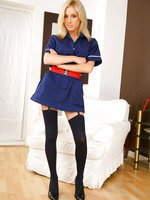 Tindra looks amazing as she teases her way out of her sexy nurse's uniform