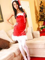 Sarah E makes for a real christmas treat in this minidress and white pantyhose.