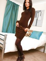 Sexy brunette looks lovely in tight minidress.