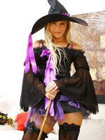 Cute Halloween Queen Jana D will show a sexy strip in a witch's outfit.