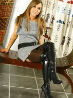 Luscious Loora in a sexy grey minidress, kinky black boots and chocolate coloured stockings.