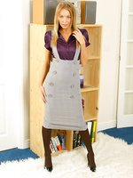 Smart secretary Hayley-Marie in a purple shirt, grey minidress and chocolate stockings.