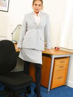 Brooke W wearing a grey secretary suit with black stockings & suspenders and red french knickers