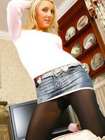 Cute blonde Jessie wearing a denim miniskirt with black pantyhose