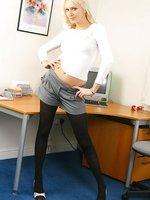 Sexy blonde secretary in a tight top, grey shorts and thick black pantyhose.