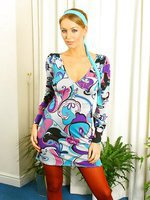 Busty blonde in a delightful purple sixties outfit with pink pantyhose.