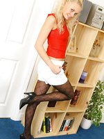 Karen is wearing a red tight top with white shorts and black patterned pantyhose