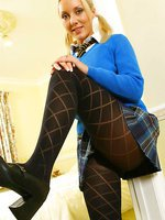 Blonde Jessie dressed in a college uniform with black patterned pantyhose