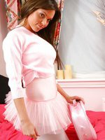 Beautiful burnette in an baby pink ballerina outfit with white pantyhose.