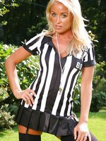 Hot blonde shows us great ball control as she slips out of her referee uniform on the football field.