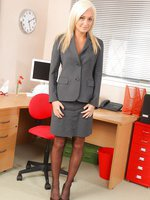 Pretty Paige D looks gorgeous in her smart grey skirt suit and sheer stockings.