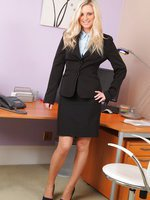 Meklaina looks smart and sexy in her black skirt suit, stockings and heels.