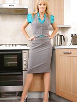 Mackenzie dressed in a grey secretary outfit with a blue blouse and beige stockings.