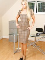 Renata looks gorgeous as she teases out of her sexy secretary outfit