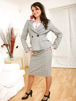 Naughty secretary Laura B slips out of her grey skirt suit revealing her cute purple lingerie