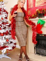 Your Gorgeous blonde secretary wishes you a happy xmas as she slips out of her tight outfit.
