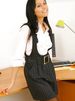 Cheeky Lily S in delightful lingerie and stockings, invites you into her office of pleasure
