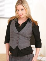 Beautiful blonde Nikki strips out of her black blouse and grey hotpants.