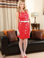 A sophisticated look for Elle in red polka dot dress and seamed stockings
