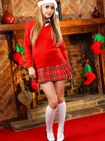 Catherine looks as gorgeous as ever in her knee high socks and red pleated miniskirt.