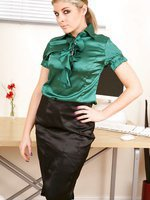 Naomi dressed as a secretary in a tight green blouse and long black skirt.