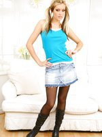 Natasha in denim miniskirt and hides her legs under black pantyhose.