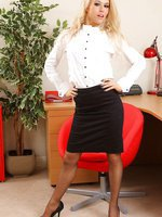 Michelle in the office with knee length skirt and grey stockings and suspenders