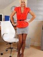 Gorgeous blonde teases in her office uniform and red lingerie