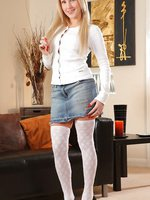 Georgi S looks cute and casual in her white top, denim miniskirt and high heels.