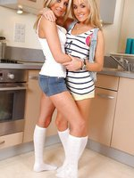 Becky and Rachael teasing in tight shorts and white knee socks