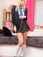 Naughty new college girl Elle slips out of her uniform.
