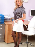 Beautiful secretary slowly teases her way of the satin blouse, white miniskirt and lace lingerie.