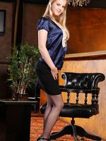 Rose hides kinky blue lingerie beneath her smart office clothes.
