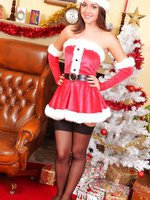 Dark haired beauty slips out of her sexy santa outfit and makes for a real Christmas treat.