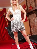 Katie K gives a sexy striptease out of her cute summer dress and poses in just her white ankle socks and high heels.