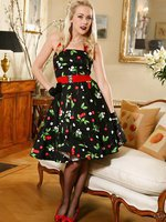 Lucy Anne looks amazing in her 50's dress and black stockings and suspenders.