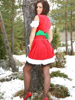 Cute Gemma Massey makes a real Christmas treat as she slips out of the sexy Christmas minidress and stockings.