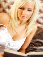 Breathtaking blonde Michelle Marsh relaxes in gorgeous white lingerie.