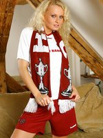 Karen stripping out of a Hearts football kit