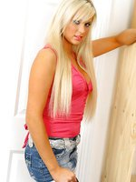 Stunning blonde in a sexy pink top, denim miniskirt, lingerie and pantyhose.