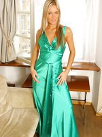 This gorgeous long blonde in an exquisite green evening dress and black stockingspl