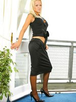 Beautiful Blonde Frankie in a smart black top, skirt and stockings.