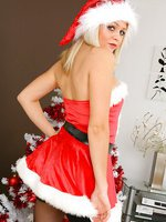 Beautiful blonde Melissa gives you a christmas treat as she wears her sexy santa outfit with dark stockings