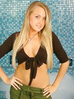 Bubbly blonde bathroom babe Lucy Anne in revealing low cut top and mini skirt with black panties and suspender set