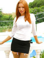 Gorgeous redhead Alex the secretary with beige stockings