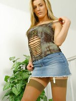 Sultry Lillia in denim mini and tan stockings