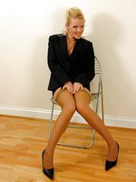 Buxom blonde secretary in tan stockings