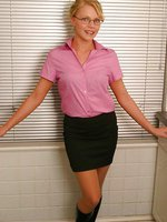 Abigail Toyne in secretary outfit with tan stockings