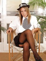 Sabrina in English WPC uniform with stockings.