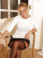 Melanie Walsh in secretary outfit with black stockings